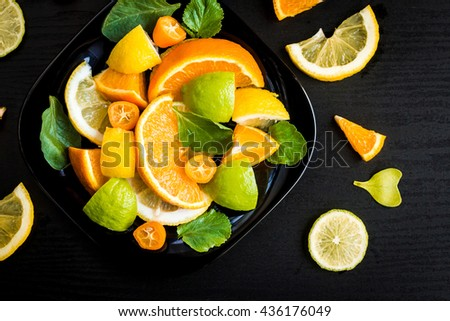 citrus salad on black background, citrus salad top view - stock photo