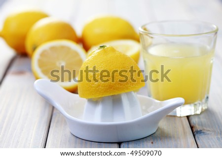 citrus squeezer and fresh lemon juice - food and drink