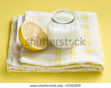 Citrus yogurt and lemon on bright yellow background - stock photo