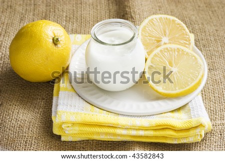 Citrus yogurt and lemons in a rustic setting - stock photo