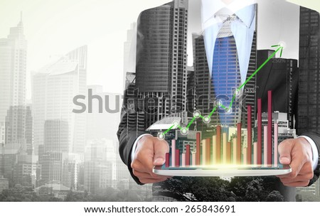 city and businessman using tablet computer. conceptual business image - stock photo