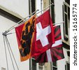 City and country flags hang outside a building in Berne, Switzerland, - stock photo