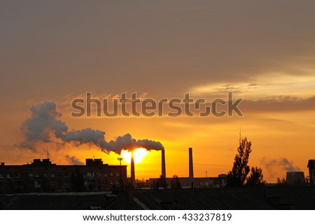 City and industry at dawn - stock photo