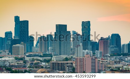 City and office building with sunset sky background