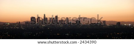 City at dawn with mountains behind - stock photo