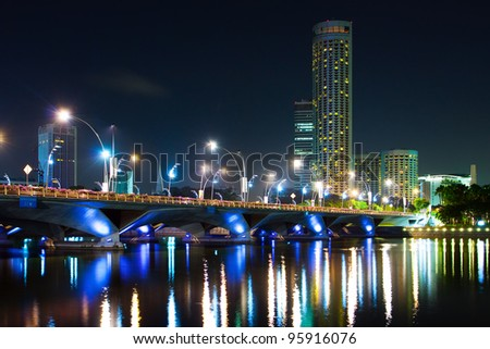 City at night in Singapore,  view of the bridge and the reflection of artificial light - stock photo