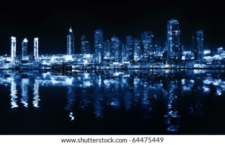 City at night, panoramic scene of downtown reflected in water, Dubai - stock photo