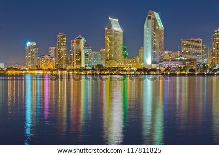 City at night, panoramic scene of downtown reflected in water, San Diego, CA, USA - stock photo