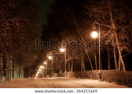 city avenue in the winter evening - stock photo