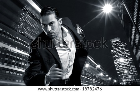 City banker running in the city - stock photo