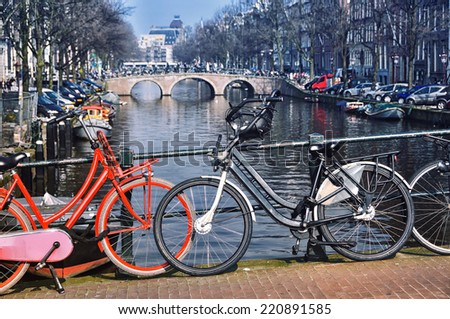 City bicycles at the bridge in Amsterdam, Netherlands