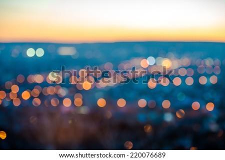 city blurring lights abstract circular bokeh on blue background with horizon, closeup   - stock photo