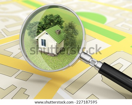 City building in tne magnifier. House search concept. - stock photo