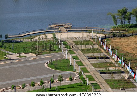 city building scenery at the side of the river, Luannan, china - stock photo