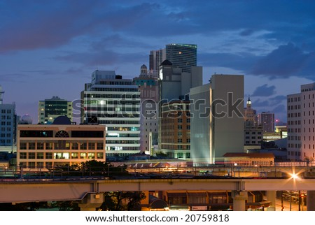 City Buildings and Mass Transit at Dawn - stock photo