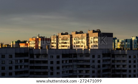 City buildings in bright sunset.