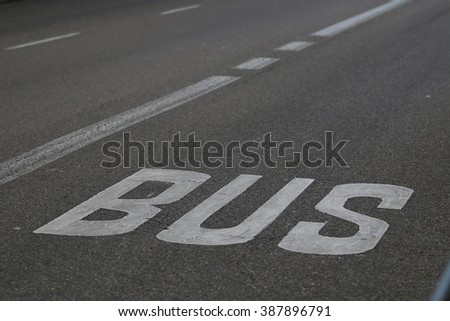 City bus transport lane sign on the asphalt road - stock photo