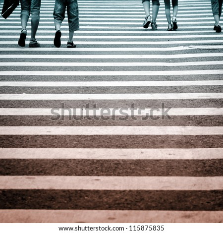 city business people crowd on zebra cross street, abstract blur - stock photo
