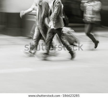 City business people walking in the commercial street, black and white blur background