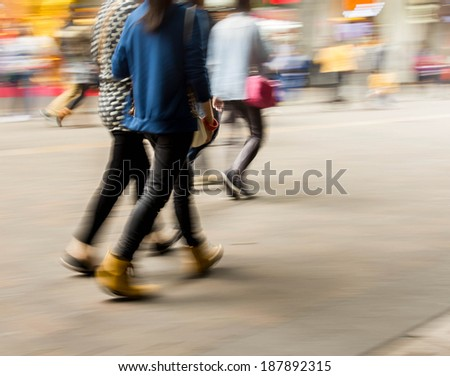 City business people walking in the commercial street, motion blur background