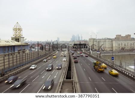 City car traffic on the bridge foggy gloomy day - stock photo