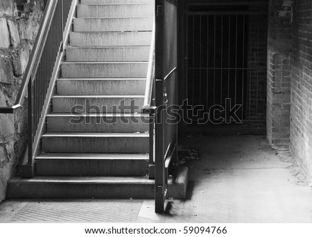 City Cellar Stairs leading down to stone and brick lower level in black and white - stock photo