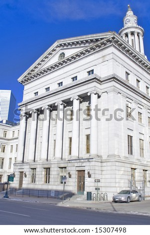 City center courthouse with architectural pillars and clock tower - stock photo