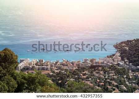 city coastline shore yachts in harbor view from mountains blue sea sun spot on seascape background - stock photo