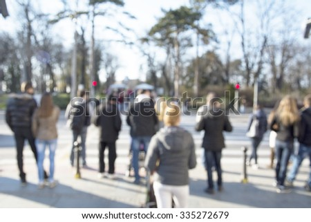City commuters. High key blurred image of people walking in the street. Unrecognizable faces. - stock photo