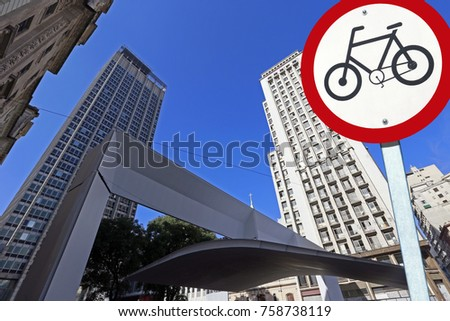 City concept : bicycle traffic permission board between buildings in perspective