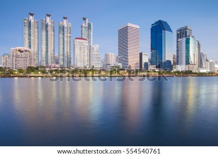 City condominium and office building with water reflection over the lake, Bangkok Thailand