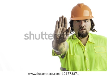 City construction worker isolated on white with his hand out showing stop