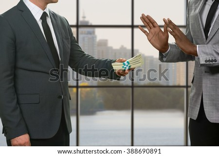 City council member refuses money. Black man rejects big money. Daytime money deal gone wrong. Business in big city. - stock photo
