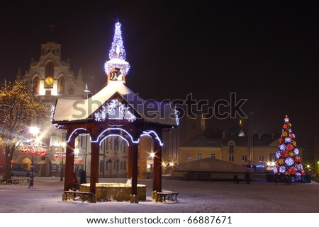 City decorated by christmas illumination - stock photo