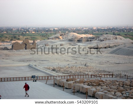 City. Desert. Ruins of Egypt on a background of the city