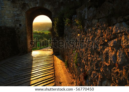 City Door in backlight An example of the medieval architecture in Tuscany with a special light - stock photo