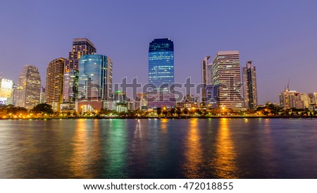 City downtown at night with reflection of skyline, Bangkok,Thailand