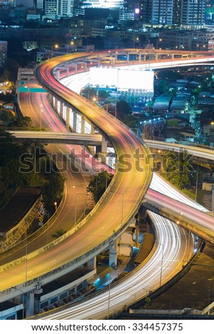 City downtown intersection overpass at night during busy hour - stock photo