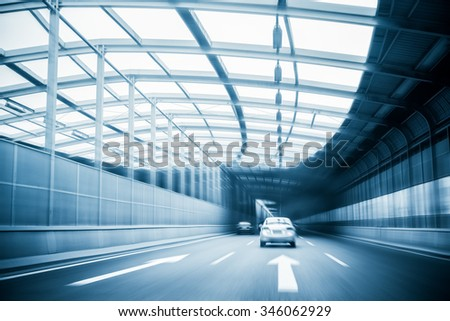 city expressway traffic in a steel structure futuristic construction - stock photo