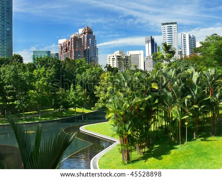 City gardens with skyscrapers and blue sky - stock photo