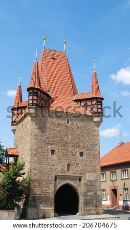 City gate with a tower in Rakovnik in the Czech Republic - stock photo