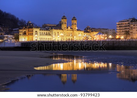 City Hall of San Sebastian (Donostia) in Spain taken from the city's famous beaches at night. - stock photo