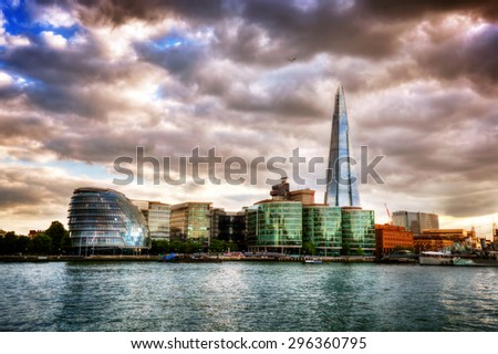 City Hall, the Shard and the More London buildings. London, England the UK. River Thames view at sunset - stock photo