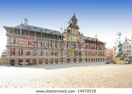 City hall with flags of many nationalities in center of Antwerp, Belgium - stock photo