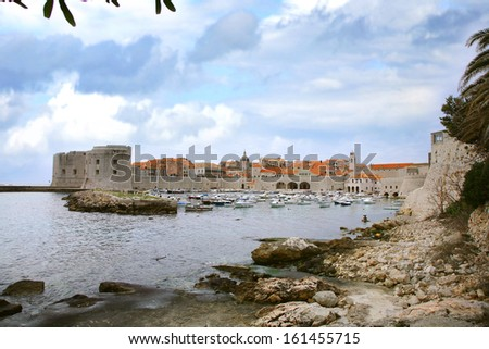 City harbor with cozy backyards in Croatia, Dubrovnik. Famous old town fortress on the Adriatic.