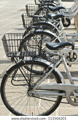 City Hire Bicycles Parked In Row - stock photo