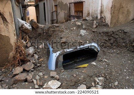 city hit by a landslide and a flood, soft focus - stock photo