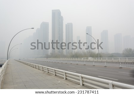 City in a heavy hazy weather. The deterioration of air quality resulted in low horizontal visibility. Located in Sanhao Bridge, Shenyang City, Liaoning Province, China. - stock photo