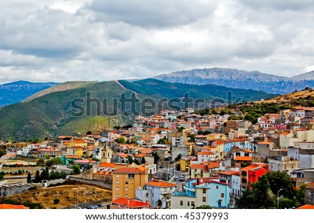 City in the mountains on the cloudy weather in sardegna - stock photo