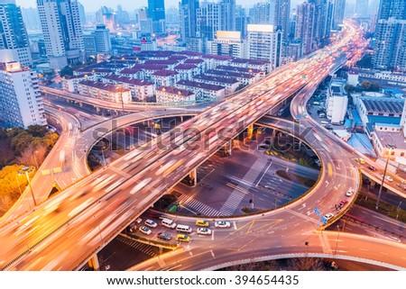 city interchange closeup at busy nightfall , shanghai, China - stock photo